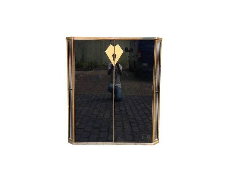 Black glass and cabinet Brass trim with chrome details Small area of damage to glass French or Italian 1970s