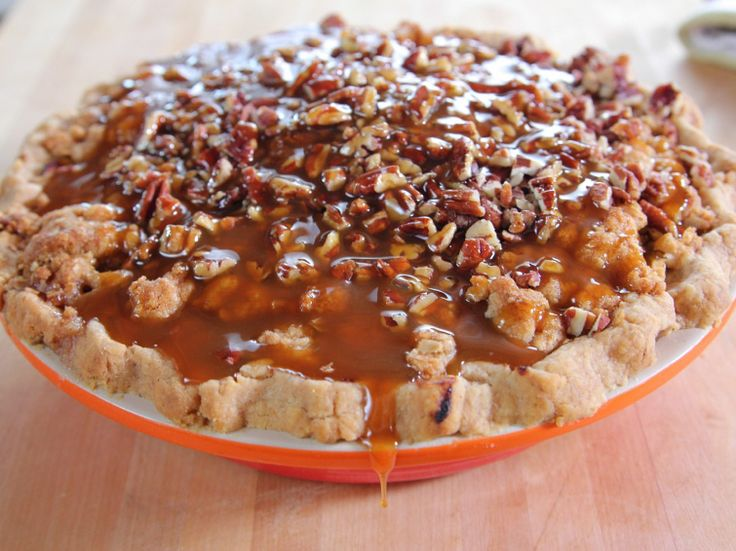 Recipe of the Day: Ree's Gooey Caramel Apple Pie Covered in an oat-packed crumble and crunchy pecans, Ree's homecrafted pie is separated from the rest by its very last step. Once it slides out of the oven, she douses it with sticky caramel, resulting in a caramel-apple creation that's as gooey as can be.