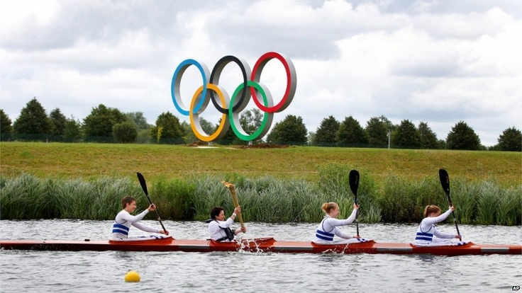 Torchbearer Sarah Winckless followed in Sir Steve's wake, carrying the flame on a boat at the Olympic rowing venue, Eton Dorney. She chose to hold the torch in both hand