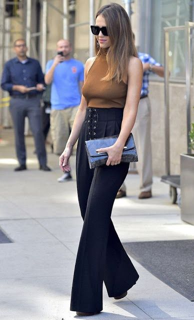 Celebrity street style | Turtle neck neutral cami with high waisted flared lace up trousers