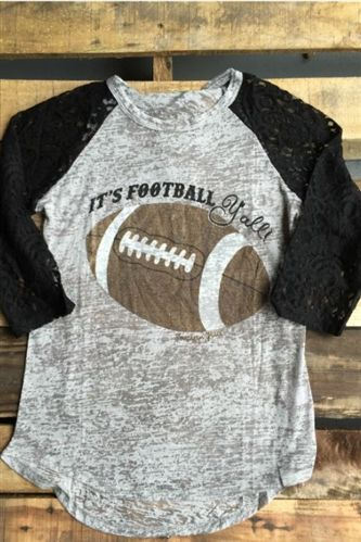 """Our Women's It's Football Y'all Lace Top is a gray and black colored top that features a grey body with black 3/4 length lace sleeves. It also features a football sparkle design with the phrase """"It's Football Y'all"""" on the front of shirt.   Use code caihar15 for 15% off your entire purchase!"""