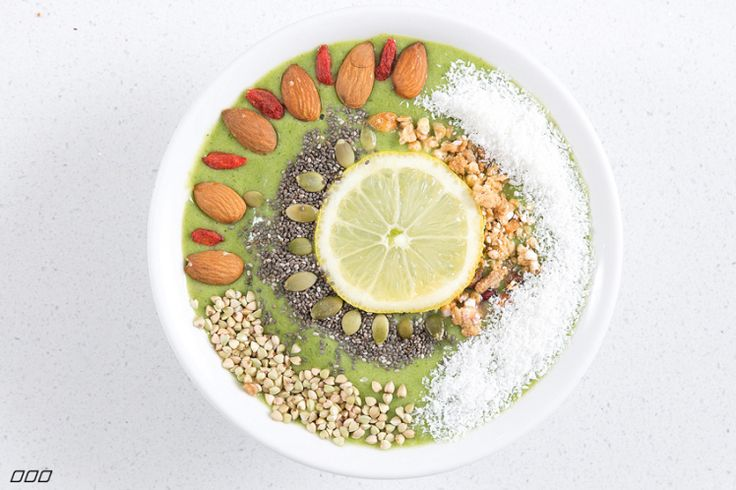 Refresh bowl: 2 frozen banana 1 kiwi fruit 1/2 cucumber handful of greens juice of half a lemon or lime small bunch of mint 2 cups coconut water 1 cup ice Combine all ingredients to blender, pour into bowl and top with a: dessicated coconut, buckwheat, almonds, goji berries, pepitas, chia seed, granola and lemon slice mandala.