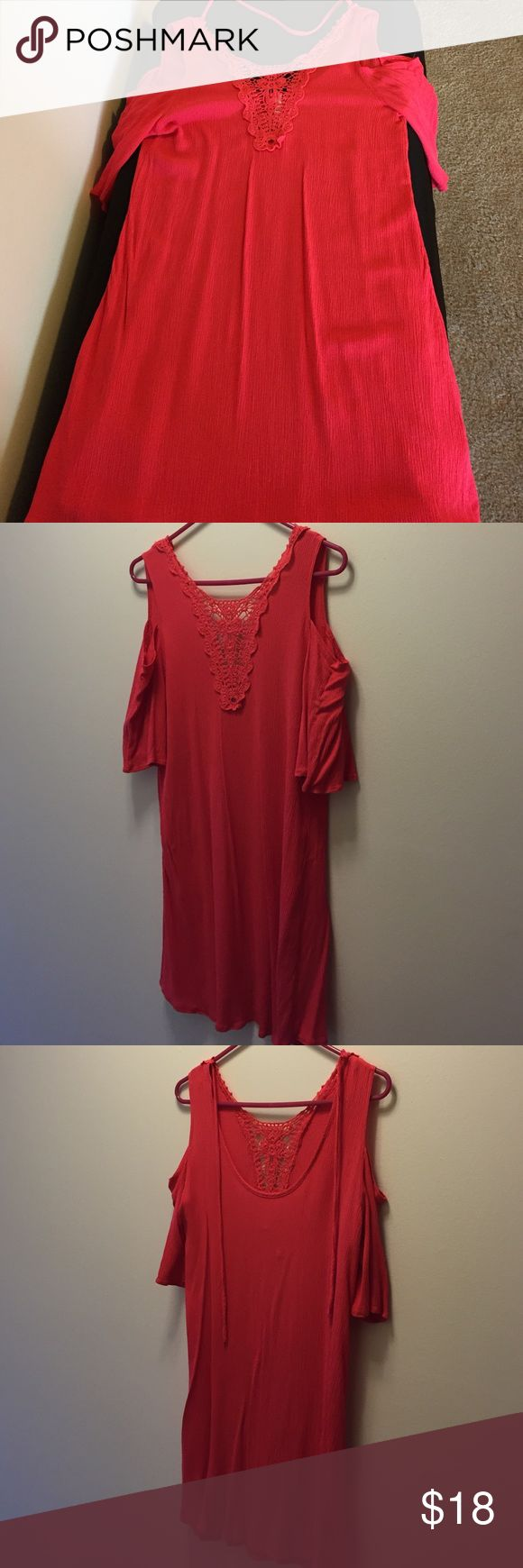 Tunic or swim suit cover up Super cute tunic or swim suit cover up. Coral color in good condition. 100% Polyester. Cut out shoulders and straps that tie up around the back of the neck. This is adorable with leggings or as a dress with cowboy boots. I'm 5'4 and it comes mid thigh on me. Brand is Noble U Tops Tunics