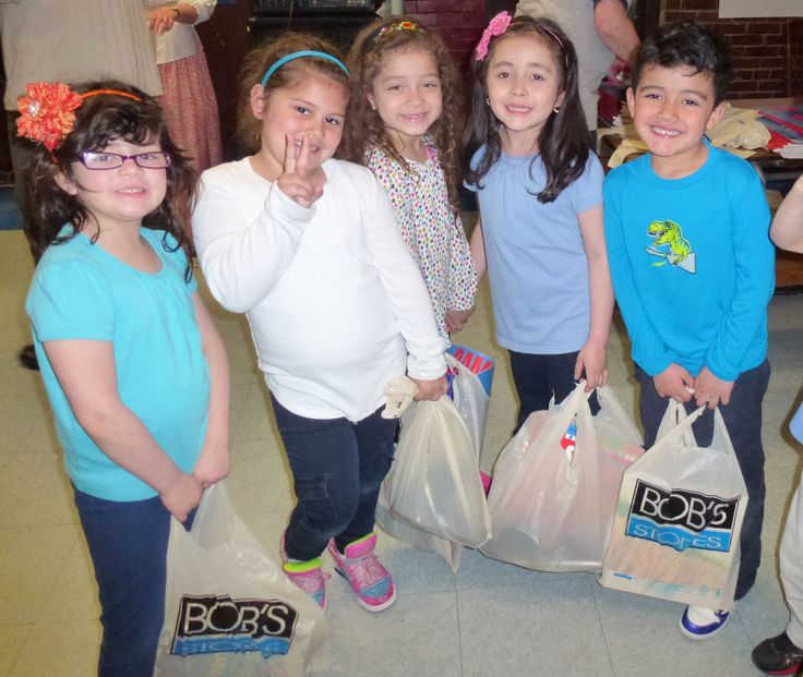 East Boston children enjoyed their new pair of shoes and book at the BOBS from SKECHERS donation event.
