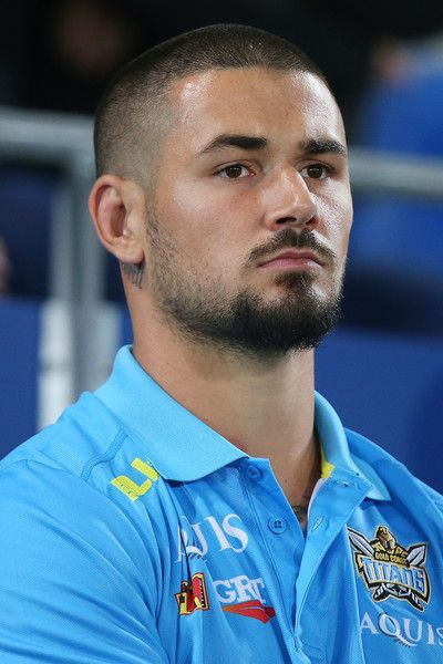 Nathan Peats Photos Photos - Nathan Peats  of the Titans looks on from the bench during the round 10 NRL match between the Gold Coast Titans and the Sydney Roosters at Cbus Super Stadium on May 16, 2016 on the Gold Coast, Australia. - NRL Rd 10 - Titans v Roosters