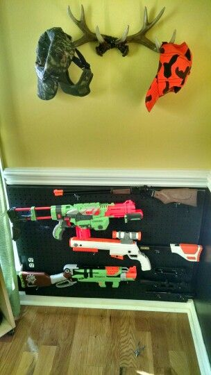 Nerf Wall Rack made from pegboard, paint the board same color as wall.