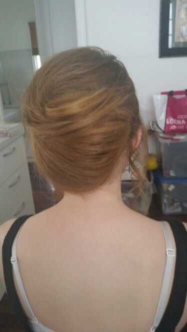 Modern French roll by Belle's Boutique Hair