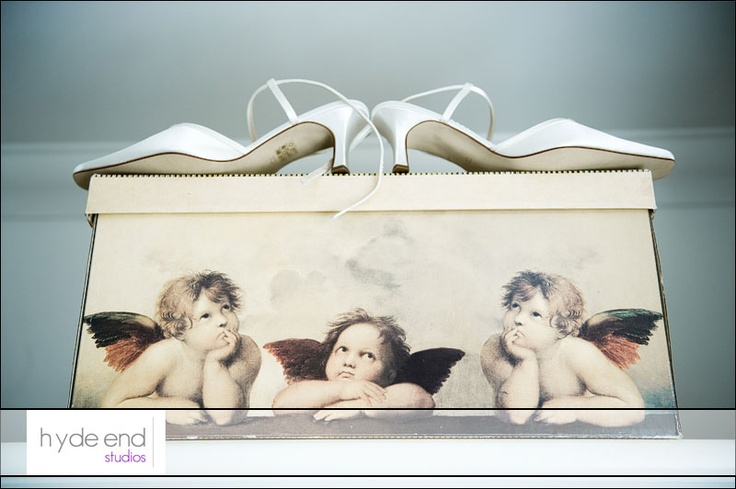 Love the way the cherubs are looking up! #weddingshoes