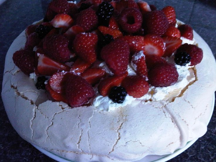 If you want a crispy, mallowy + 100% sticky pavlova this is the recipe for you. Served with fresh berries, and thick whipped cream, this recipe is definetly a winner!!