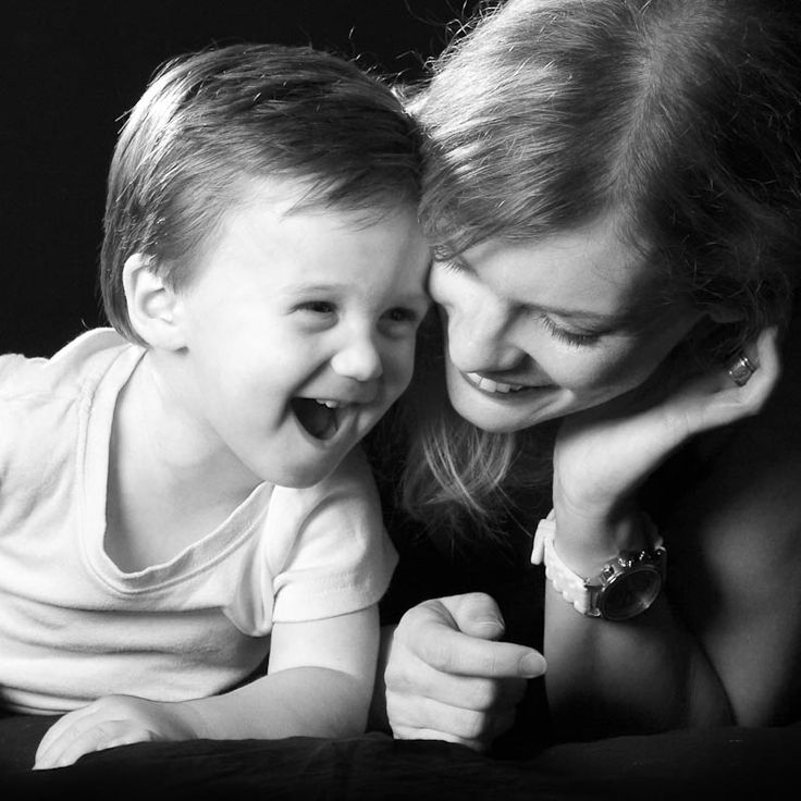 Black and white photograph of mother and son laughing in the Perth photography…
