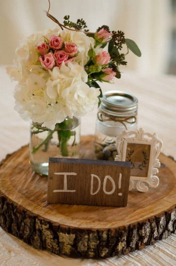 rustic tree stump and mason jar wedding centerpiece / http://www.deerpearlflowers.com/unique-wedding-centerpiece-ideas/3/