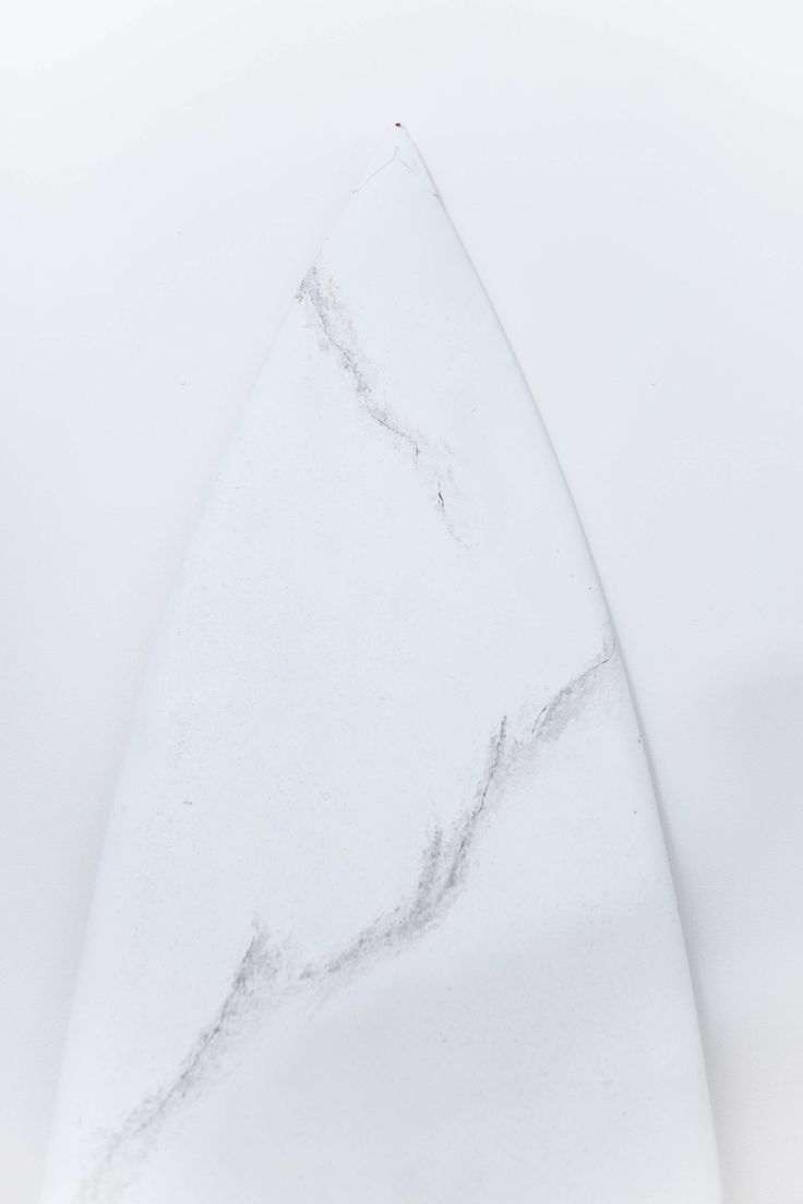 Marbleize a surfboard with white and gray paint for a piece of art that looks absolutely statuesque!