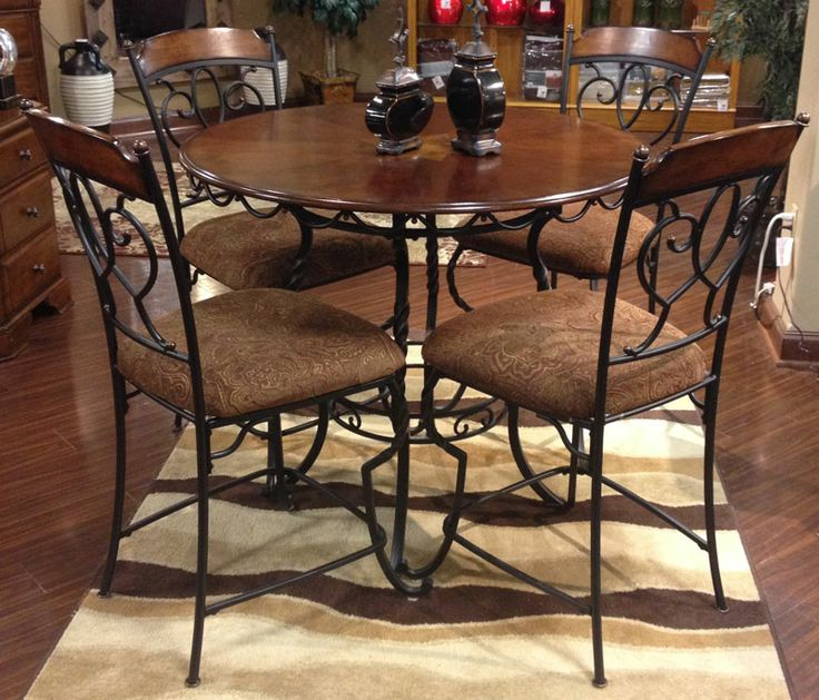 Nola Dining Table amp 4 Side Chairs The ornate beauty of the  : d3b92e7b4d6d3d9b0efb2d4c81a27d68 metal tables table bases from www.pinterest.com size 736 x 629 jpeg 93kB