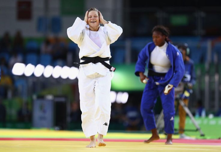 <p>Tina Trstenjak of Slovenia celebrates victory over Clarisse Agbegnenou of France in the Women's -63kg gold medal bout on Day 4 of the Rio 2016 Olympic Games at the…