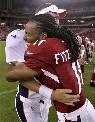Larry Fitzgerald (11) hugs Denver Broncos quarterback Peyton Manning.... Love this pic.