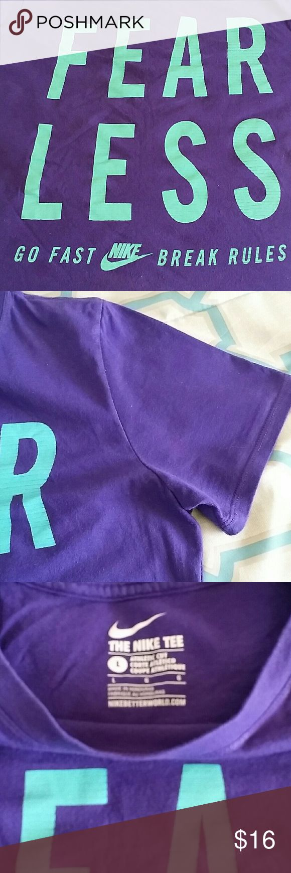 "Nike Athletic Cut Workout Shirt. ""Fear Less. Go Fast Break Rules.""  Purple Nike Athletic Cut workout shirt in great condition.  All of my workout shirts are washed in cold water and none of them are dried, helping to keep their shape and color. Nike Tops Tees - Short Sleeve"