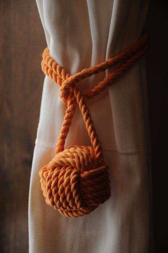 Handmade I made these from 3 strand cotton rope, they are a nice orange. I have also have a sunshine orange that is a really bright orange but this