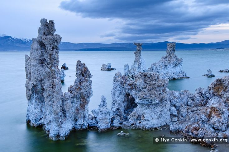 Lake Mono at Twilight, Mono Lake Tufa State Reserve, Eastern Sierra, Mono County, California, USA. Tufa towers at the South Tufa Area, Mono Lake Tufa State Natural Reserve, Mono Lake, California. Tufa is formed when springs under the lake mix calcium-rich freshwater with alkaline lakewater, precipitating deposits of calcium carbonate. The lake level has dropped more than 30 feet since 1941, when the city of Los Angeles began diverting water from the streams that feed it, exposing the…