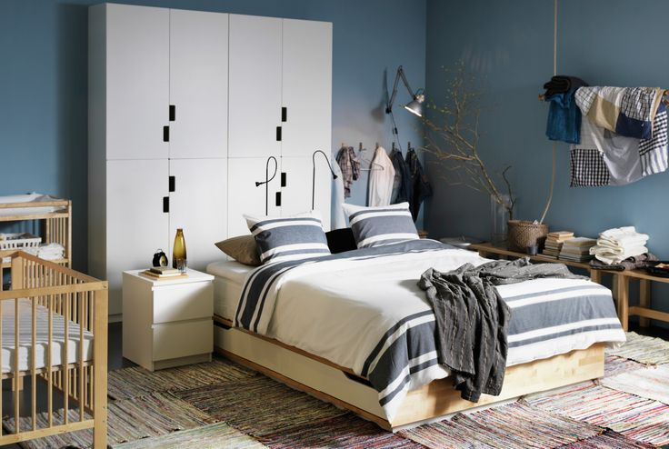 Bedroom with IKEA bed, sidetables, chest of drawers all in wood. **I like the side tables**
