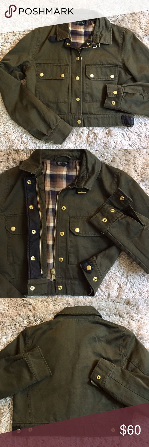🇺🇸 SALE 🇺🇸 Topshop Military Cropped Jacket + Worn once, great condition. + Plaid lining 🍂🍃 Perfect for fall!  + Gold buttons and zipper accents  + Two front pockets  + Buckle collar    + Don't forget to bundle with other Topshop items  ⭐️All items are steamed cleaned and shipped within 48 hours of your purchase. ⭐️If you would like any additional photos or have any questions please let me know. ⭐️Sorry, no trades. But will listen to ALL fair offers. Thanks for shopping! Topshop Jackets…