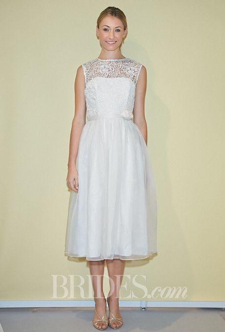 "Brides: Siri - Fall 2014. Style 9181, ""Petula"" sleeveless tea-length macrame lace and sheer organza A-line wedding dress with an illusion high neckline, Siri"