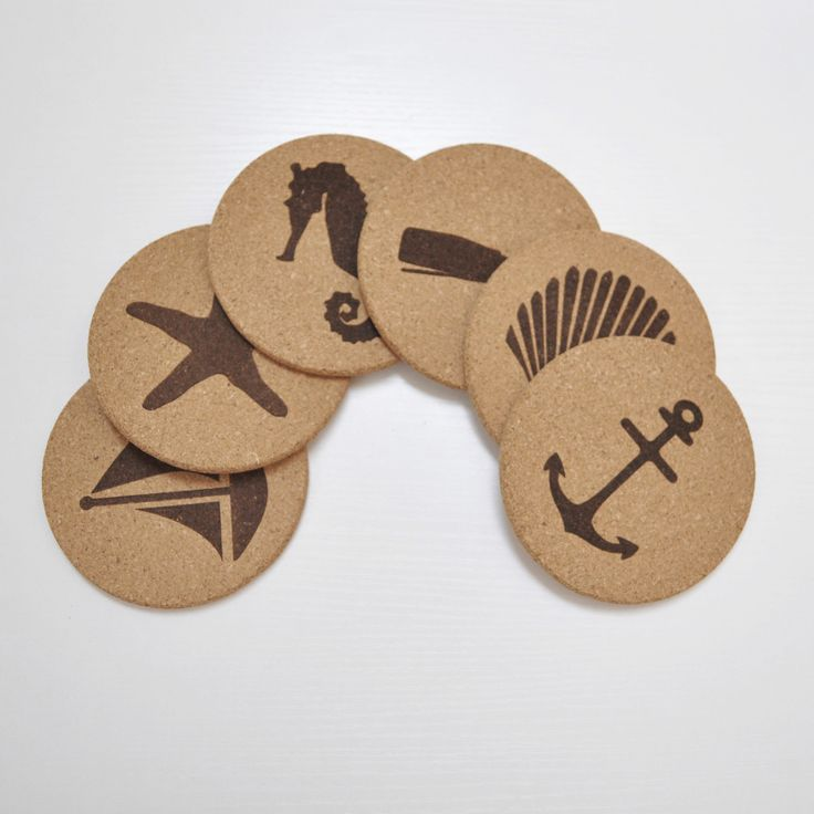 "Instantly transport yourself to the beach with Jetty Home's nautical cork coaster set. This set of fine grain, all-natural wine and drink cork coasters includes six pieces, which measure 4.25"" in diam"