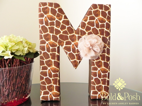 This beautiful giraffe print is the perfect decor accent to any safari themed nursery or room. Perfect to give as a birthday gift, or birthday party decoration on a sweets table, the possibilities are endless.    The letter features a lovely giraffe print on cotton fabric with silk chocolate ribbon on the sides.    This letter is completely customizable and can be covered in other animal print fabrics.