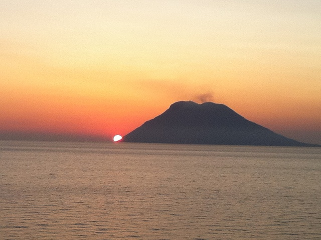 Sunset at Mount Stromboli (and Island), Italy - Active Volcano Puffing Smoke and Lava