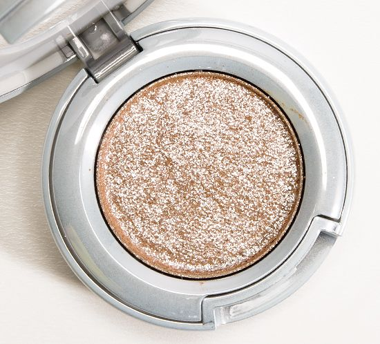 Urban Decay Space Cowboy Moondust Eyeshadow Review, Photos, SwatchesSpace Cowboy had similar color payoff used both dry and wet; applying it damp did intensify the underlying base color ever-so-slightly. Even the finish is the same: sparkly, metallic, but it doesn't smooth down as fully as other shades in the range.