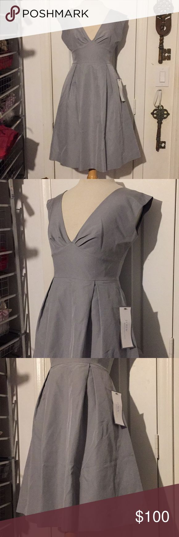 NWT J. Crew Size 2 Silver Gray Silk & Cotton Dress NWT J. Crew Size 2 SilverGray, Silk & Cotton Special Occasion Cocktail Dress! Gorgeous cap sleeves, zip back, fully lined and petite pleats. Absolutely stunning and classic! No snags or stains! J. Crew Dresses