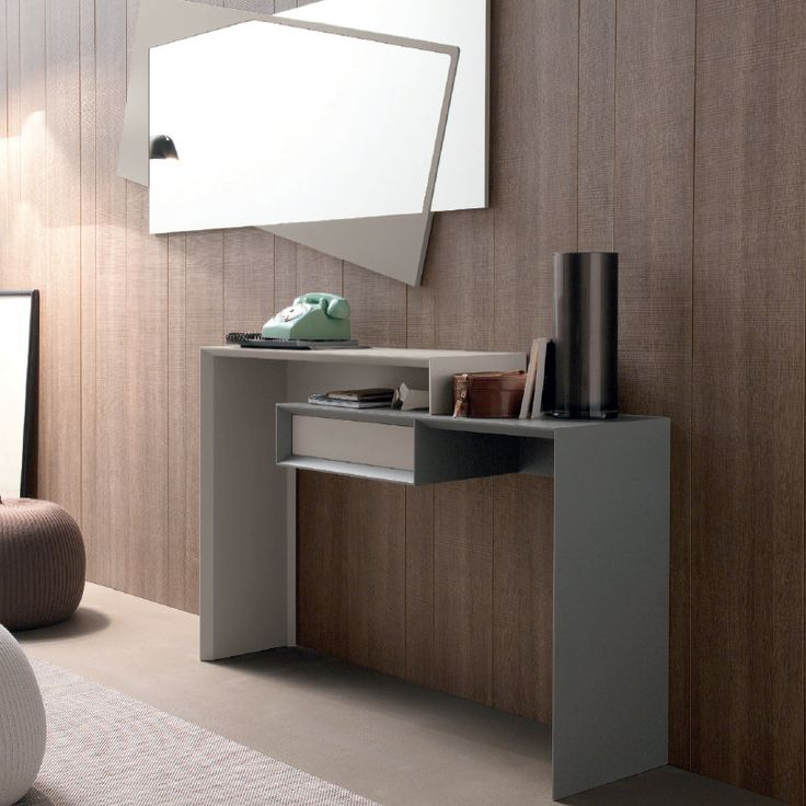 Smart Mirror and Console Table These ultramodern pieces are amazing if your house is furnished in a contemporary style. The colours are very sober but they give a lot of personality to any other colour you may have. They can easily be applied to the wall.
