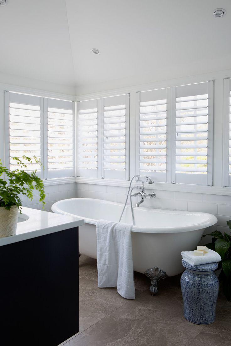 Queenslander style bathroom .White shutters ,claw foot bath , perfect white .