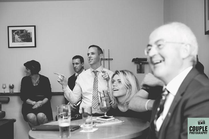 The guests enjoy the Rugby world Cup Final. Wedding at Castle Dargan Hotel Photographed by Couple Photography. Ireland.