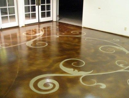 The free-form vine and leaf pattern adds graceful movement to this concrete floor by Floor Seasons, Inc. in Las Vegas, NV.