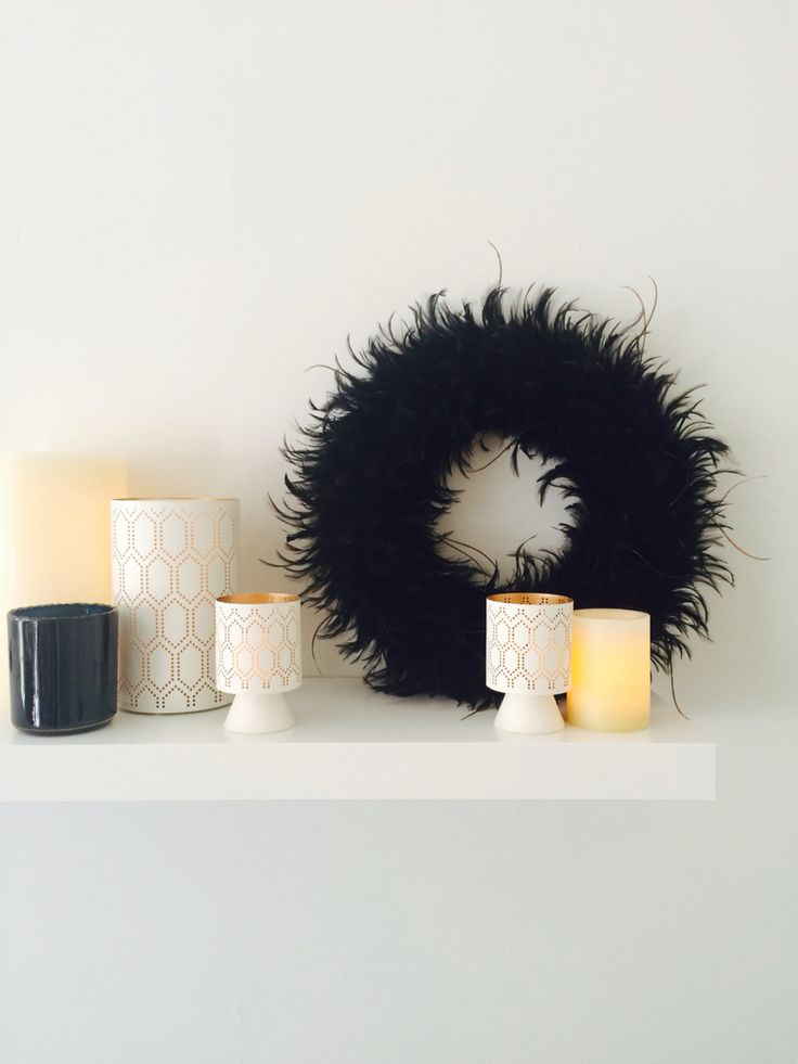 I've had this black feather wreath for years - it goes with so much and packs a visual punch against the warm glow of these candles. #blackmagic #ikea #ikeashelf #therealshelflife #candles #candleobsession #lovethislook #shelfstyling #ikeashelfstyling #lackshelf #diyinteriors #diystyling #diydesign #blackandwhitestyle #blackandwhite #usewhatyouhave