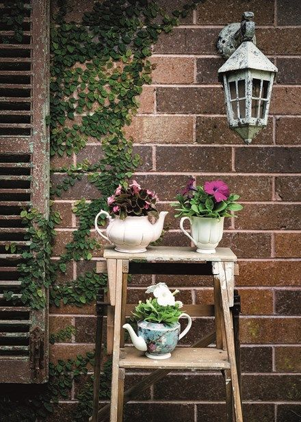 Decorate with flowers - Set up a whimsical display in your garden using old teapots as planters. Home Beautiful