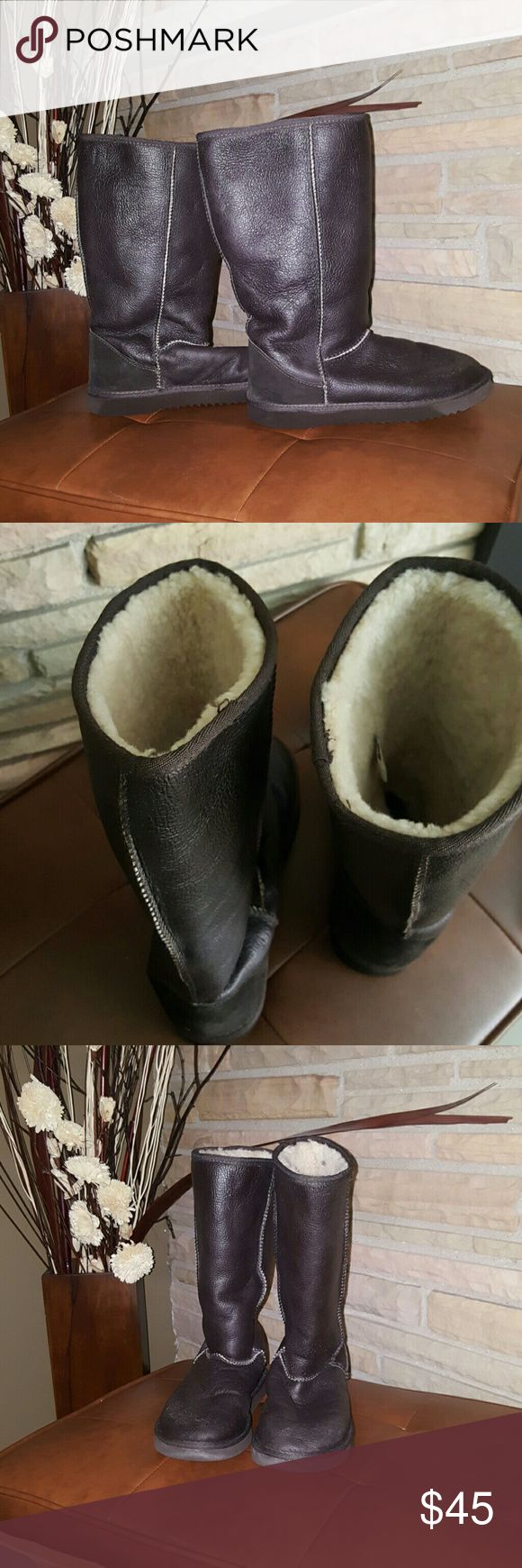 Tall Classic winter Sheepskin boots Not sure what brand these are but these do have real Sheepskin upper, Sheepskin insock & synthetic sole. Color is Dark Brown with Cream interior. These are in Excellent used condition. These are not uggs. Just under the category for exposure. UGG Shoes Winter & Rain Boots