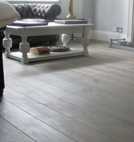To me, the ultimate wooden floor has large boards, and has grey tones.