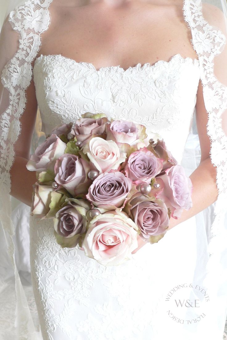 Sweet Avalanche, Amnesia & Memory Lane Roses were used to create this beautiful Antique looking Bouquet...we added some Vintage Pink Pearls to add to the glamour...www.weddingandevents.co.uk