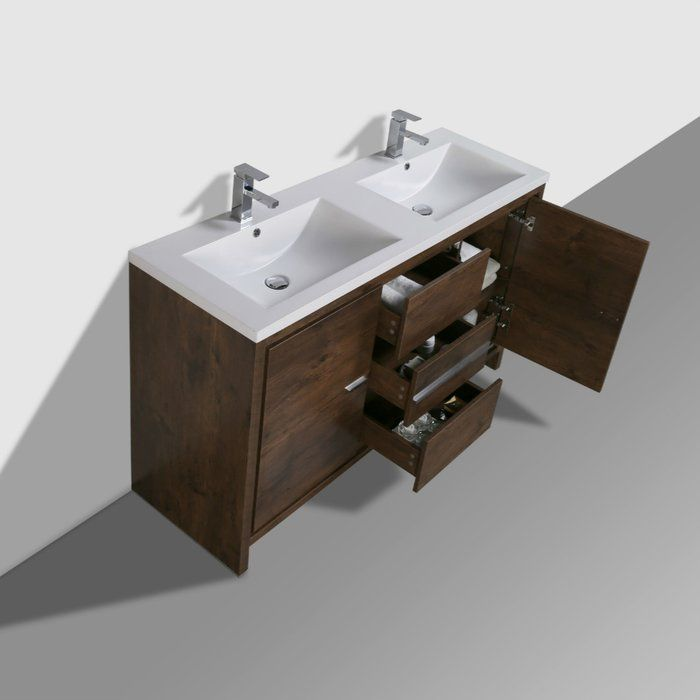 This Free Standing Modern Double Bathroom Vanity Set is one of the most elegant modern Bathroom Vanities around. This double sink model comes with a durable pure white acrylic countertop and features 2 doors and 3 drawers with high quality European hardware, that provides smooth soft-closing operation. Top drawer features push-open operation.