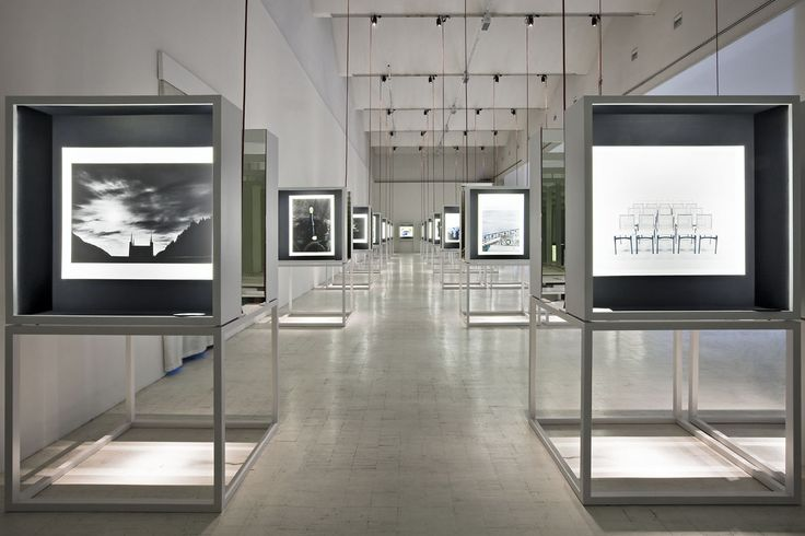 A #landscape of images marked by an #evocative path, in the middle of lights and #reflections. #tripthroughoutItaly #design #white #exhibition