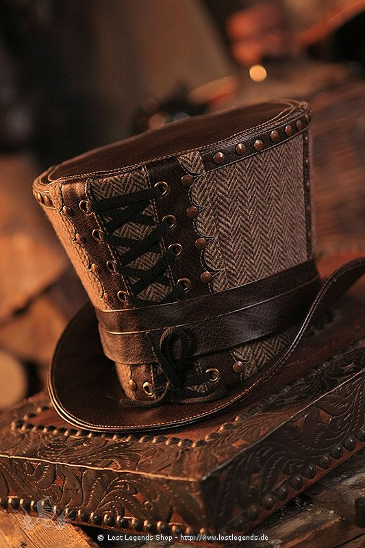 Tweed and leather lacquer hat. Decorated with copper rivets and lacing