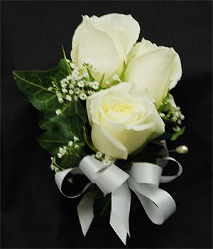 Norfolk Florist White Rose Cluster Corsage is Designed with Three Soft White Roses Accented with Ivy and Babys Breath. This pin on Corsage can easily be designed as a wrist corsage by choosing a wrist band below.