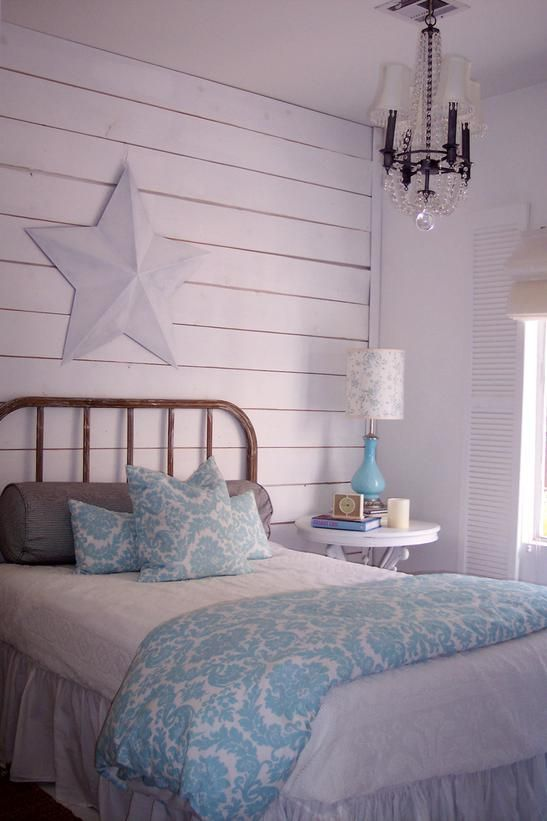 Beach Cottage Decor - Beachy bedroom - Beach Bedroom  White is a staple for creating a beachy look in the bedroom. Paired with pale blue accessories, a vintage chandelier and a distressed headboard.