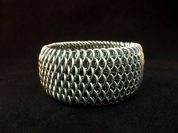 Check out this item in my Etsy shop https://www.etsy.com/au/listing/561341537/chainmaille-dragonscale-bangle-silver