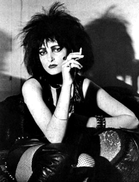 Siouxsie Sioux. Of the 'goth' bands I've heard, her's came closest to the ideal of goth. Stunning voice too.