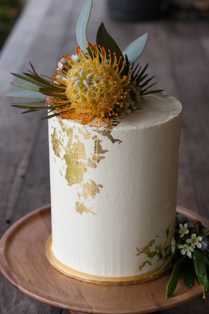 [Homemade] Lemon sponge tower cake with blackberry compote gold foil and Australian native flowers.