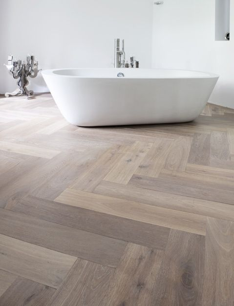 Gorgeous whitewashed effect parquet herringbone flooring!