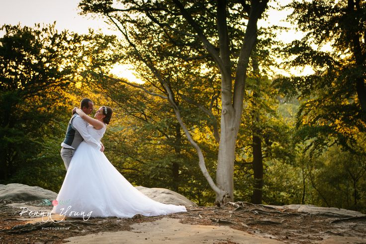 Bride and groom portraits. Sunset couple shots. Summer wedding at High Rocks in Tunbridge Wells Kent.  Church wedding. St Pauls Church in Rusthall Tunbridge Wells Kent. Photography by Penny Young Photography.