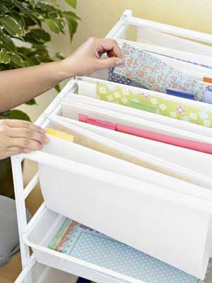 Leah organizes paper scraps by color in this Elfa rolling cart tucked within reach of her desk. She gave each file a color tab. Any similar-color patterned paper or cardstock goes into the file, with patterned paper in the front, cardstock in the back. The two drawers below the files contain scraps she hasn't had time to sort.